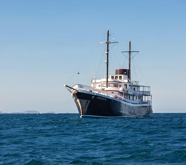 Evolution ship sailing the Galapagos Islands