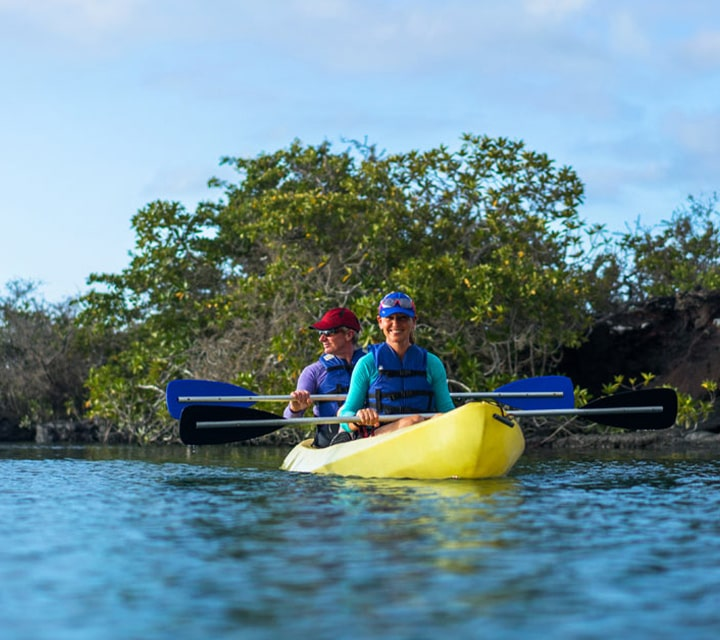 Couple kayaking in the Galapagos Islands