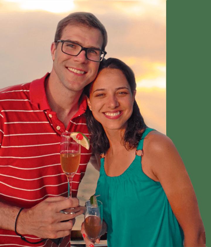 Sunset setting for honeymooners celebrating with champagne