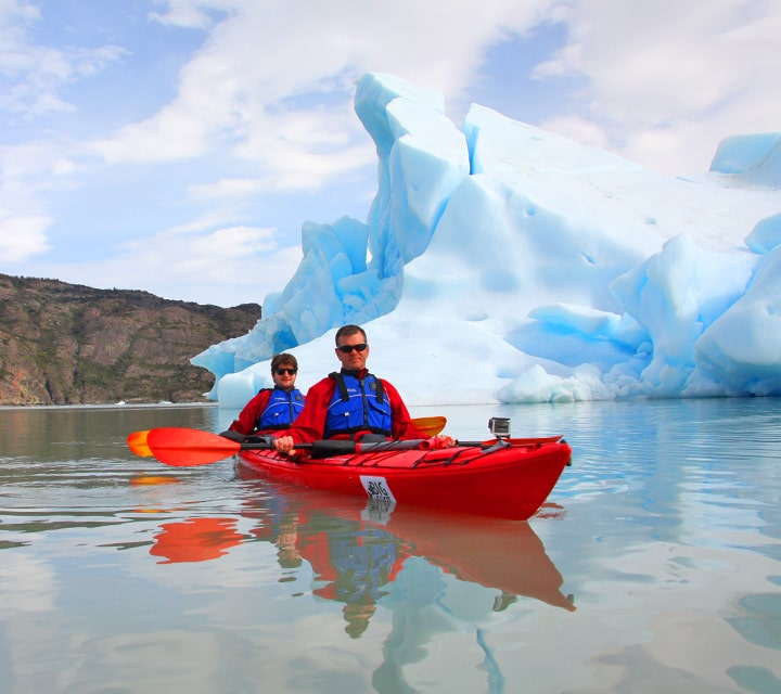 Sea kayaking in grey glacier in Patagonia