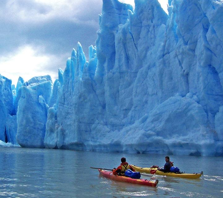Kayaking by huge glaciers in Patagonia