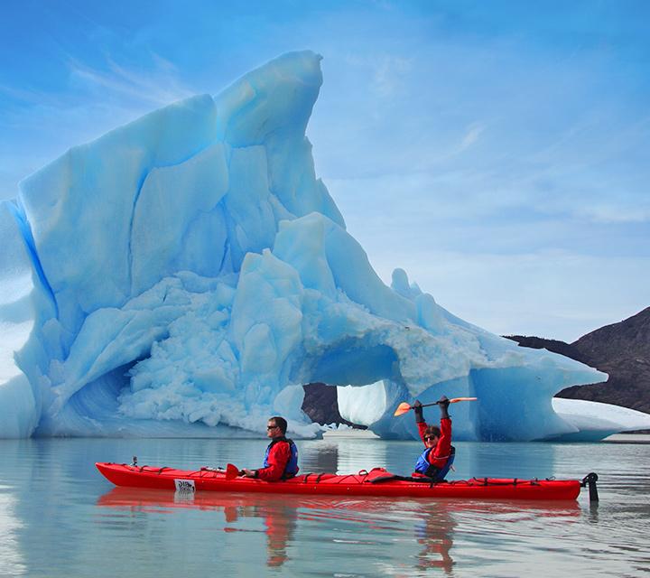 Kayaking by glaciers in Patagonia