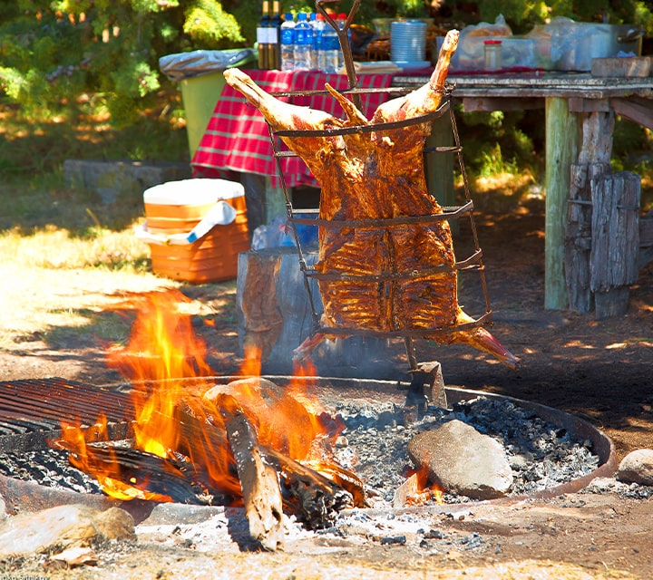 Traditional Argentinean asado prepared outdoors for a culture rich experience for Patagonian guests