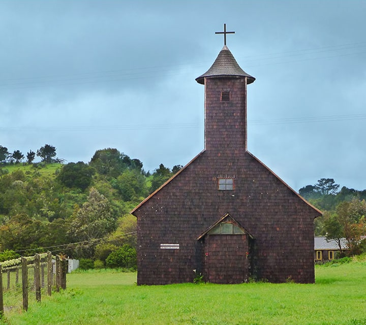 Chiloé Churches, significant architectural structures protected by the 1996 World Monuments Watch yield tourism, traditions and culture