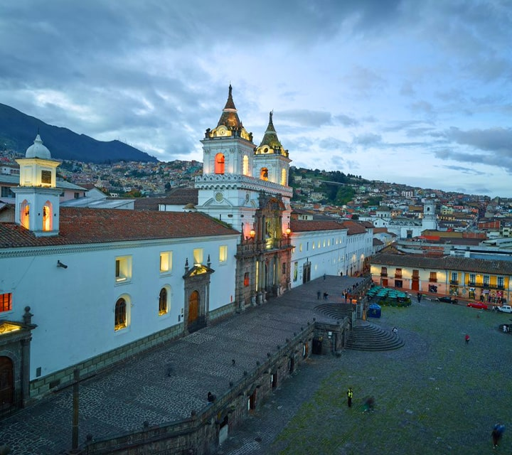 Colonial Quito in the evening with rolling hills in the background