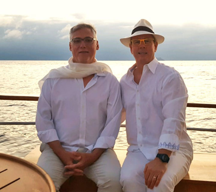 Michael Murphy and his husband lounging aboard the privately chartered Grace Yacht by Quasar Expeditions